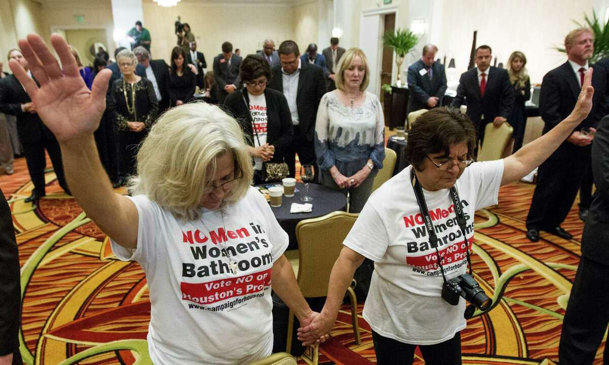 Rita Palomarez, left, and Linda Rodriguez pray during an election watch party attended by opponents of the Houston Equal Rights Ordinance on Tuesday, Nov. 3, 2015, in Houston. ( Brett Coomer / Houston Chronicle )