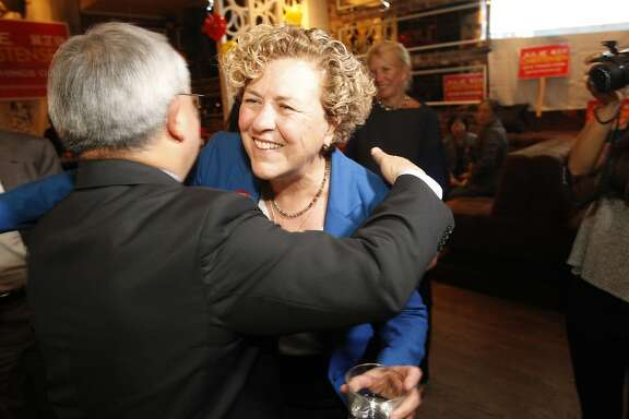 District 3 Supervisor candidate Julie Christensen gets a hug from Mayor Ed Lee on election night in San Francisco on Tuesday, Nov. 3, 2015.