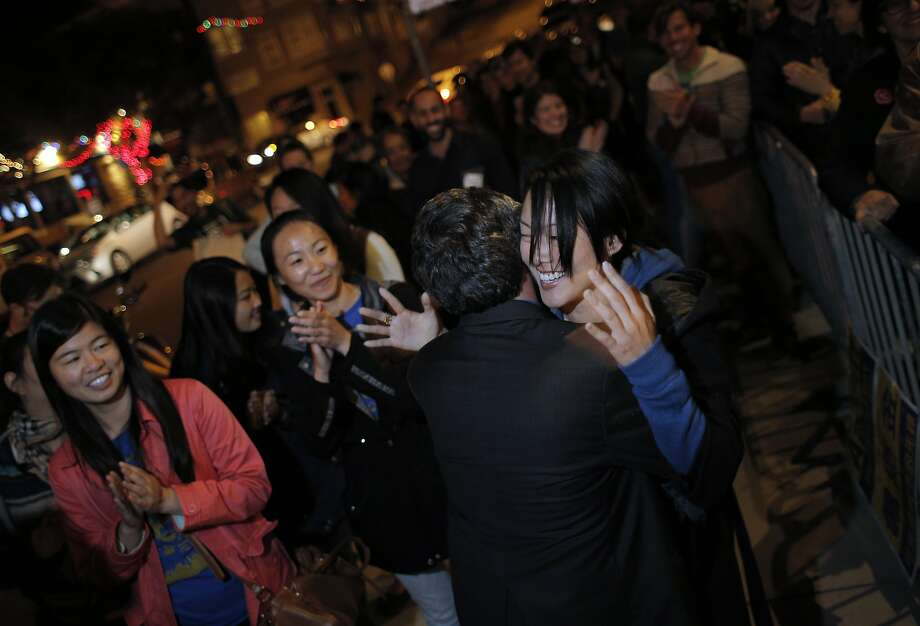 Aaron Peskin, center, hugs Supervisor Jane Kim, right, at the election party for Peskin. Photo: Carlos Avila Gonzalez, The Chronicle