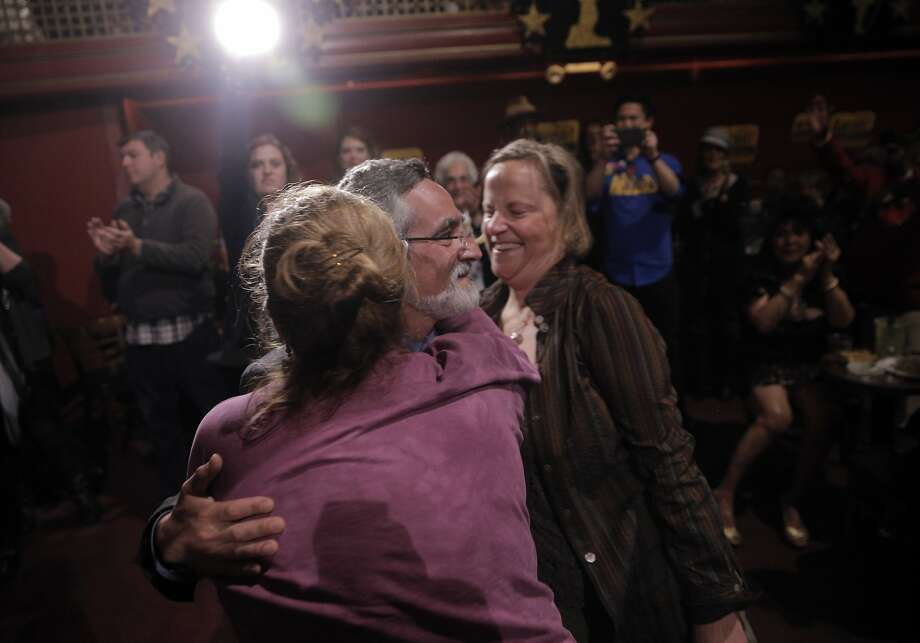 Aaron Peskin gets a hug from Savannah Blackwell, left, and Dawn Trennert, right, during the election party for Aaron Peskin and his campaign for supervisor of District 3 at Club Fugazzi in North Beach on election day in San Francisco, Calif., on Tuesday, November 3, 2015. Photo: Carlos Avila Gonzalez, The Chronicle