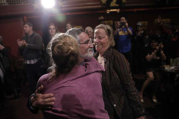 Aaron Peskin gets a hug from Savannah Blackwell, left, and Dawn Trennert, right, during the election party for Aaron Peskin and his campaign for supervisor of District 3 at Club Fugazzi in North Beach on election day in San Francisco, Calif., on Tuesday, November 3, 2015.