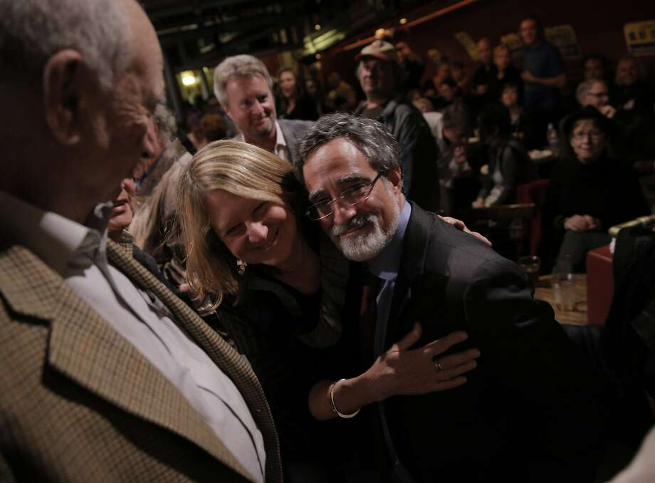 Aaron Peskin hugs his wife Nancy Shanahan, center, at the election party for Aaron Peskin and his campaign for supervisor of District 3 at Club Fugazzi in North Beach on election day in San Francisco, Calif., on Tuesday, November 3, 2015. Photo: Carlos Avila Gonzalez, The Chronicle