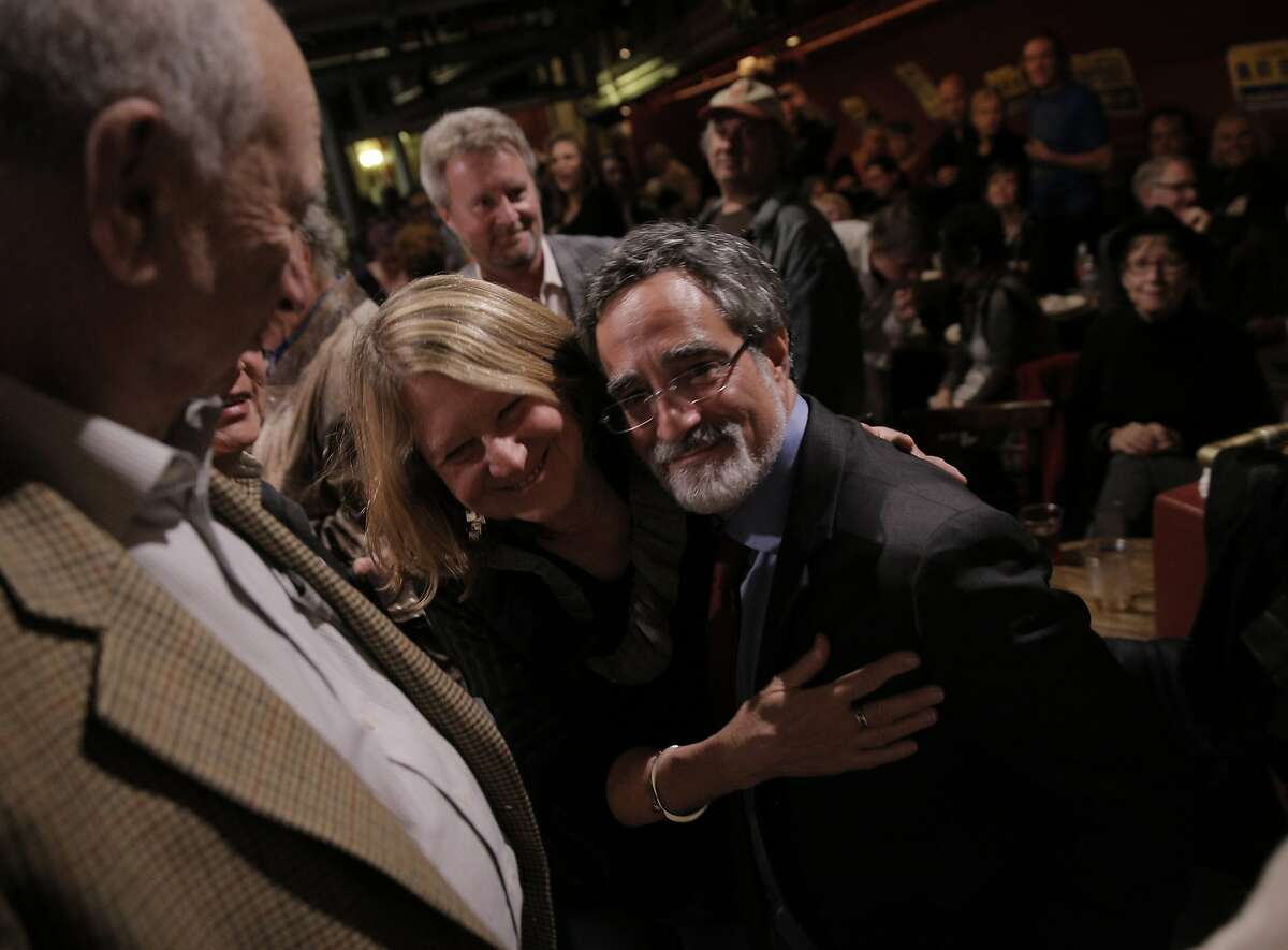 Aaron Peskin hugs his wife Nancy Shanahan, center, at the election party for Aaron Peskin and his campaign for supervisor of District 3 at Club Fugazzi in North Beach on election day in San Francisco, Calif., on Tuesday, November 3, 2015.