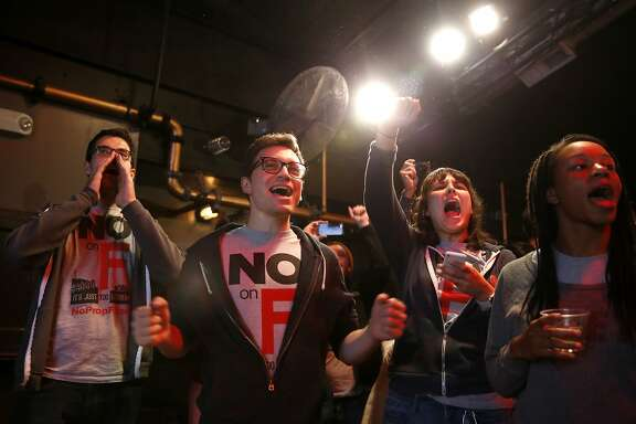Opponents of Prop F celebrate its defeat during an election night party at Oasis in San Francisco, California, on Tuesday, Nov. 3, 2015.