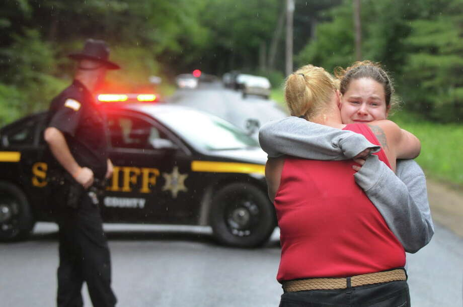Mindy Laport, daughter of Richard Laport, right, embraces her friend Lisa Burroughs on Tuesday, June 30, 2015, in Edinburg, N.Y. Richard Laport, 51, died after an encounter with officers. (Cindy Schultz / Times Union) Photo: Cindy Schultz / 00032443A