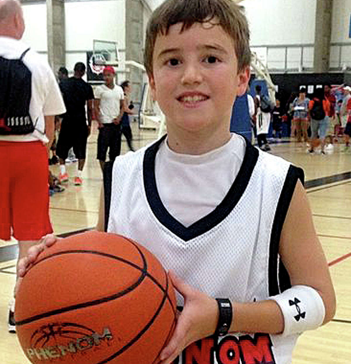 The Adam Greenlee Foundation is helping to organize a campaign to make automated external defibrillators available at all of the town's school athletics facilitie, as well as portable AEDs for Westport students on the road. In 2014, Adam Greenlee Jr., pictured, then a sixth-grader at Bedford Middle School, suffered a seizure and cardiac arrest, but was revived by staff who treated him with an AED and cardio-pulmonary resuscitation before he was taken to a hospital.