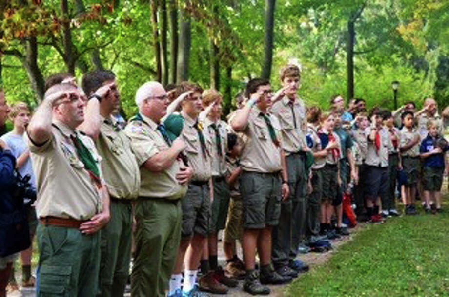 Scouts and leaders salute at the recent Boy Scout Community Camporee in Tilley Pond Park in Darien. Photo: Contributed / Contributed Photo / Darien News