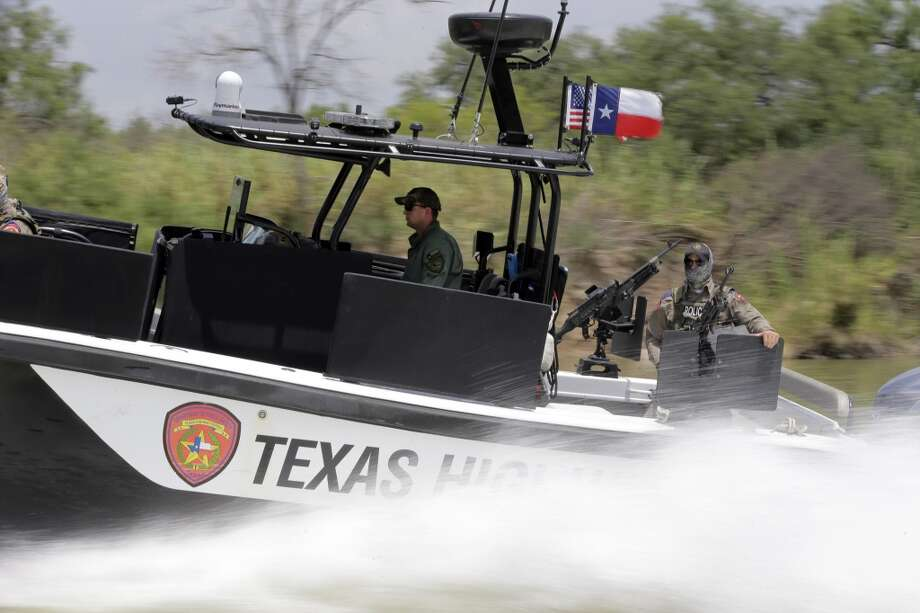 Total number of tactical boats: 13 Photo: Eric Gay, Associated Press