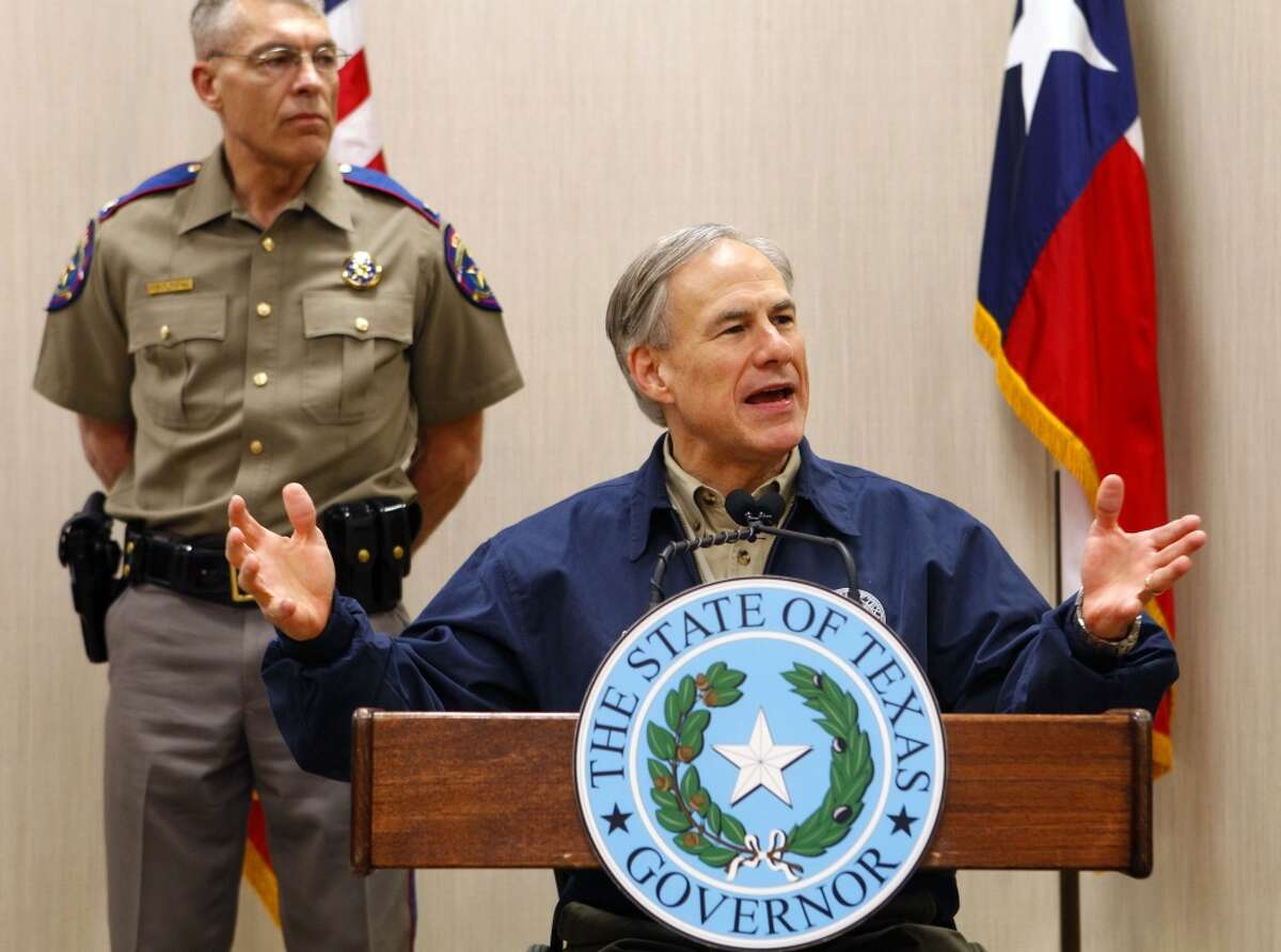 Texas Gov. Greg Abbott talks about his border security plan during a news conference as Texas Department of Public Safety Director Steve McCraw stands behind him Friday, March 27, 2015 at DPS' Region 3 Headquarters in Weslaco, Texas. Abbott remains noncommittal on a timeline for pulling the National Guard off the Texas-Mexico border after hundreds of police officers applied for jobs to effectively replace those troops. (AP Photo/The Monitor, Nathan Lambrecht) MAGS OUT; TV OUT