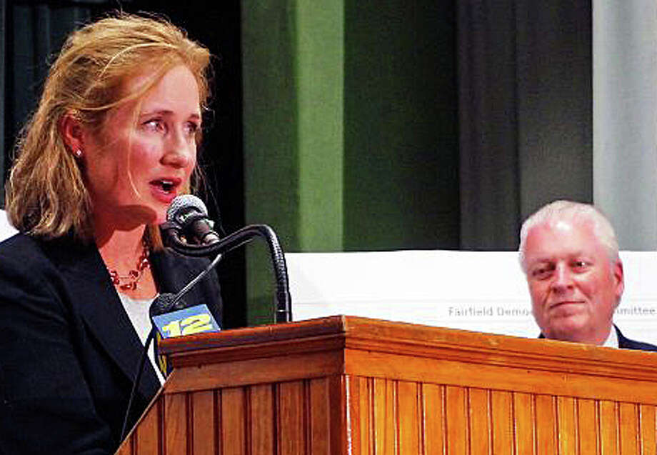 Selectman Sheila Marmion addresses Democrats' election night gathering Tuesday as First Selectman Michael Tetreau looks. Preliminary results show that Marmion may have lost her seat on the Board of Selectmen even though Tetreau was re-elected. Photo: Genevieve Reilly / Fairfield Cit / Genevieve Reilly / Fairfield Citizen