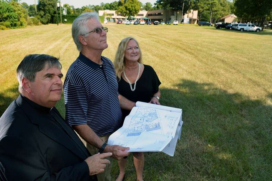 The Rev. John Keller, left, pastor of the Prince of Peace Catholic Community, surveys the future site of three new church buildings with building committee representatives David Taylor and Rita Forness. Photo: Jerry Baker, Freelance