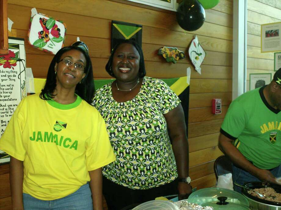 Andrea Condell-Stewart and Michelle Patterson are representing their country of Jamaica with some Jerk chicken, rice and peas, fried plantains and ginger beer. They also have decorations, pictures and information about their country to share. Photo: St. Cuthbert Episcopal Church
