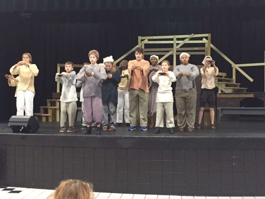 Cast of Oliver rehearsing at Westbury Christian School. Photo: Courtesy