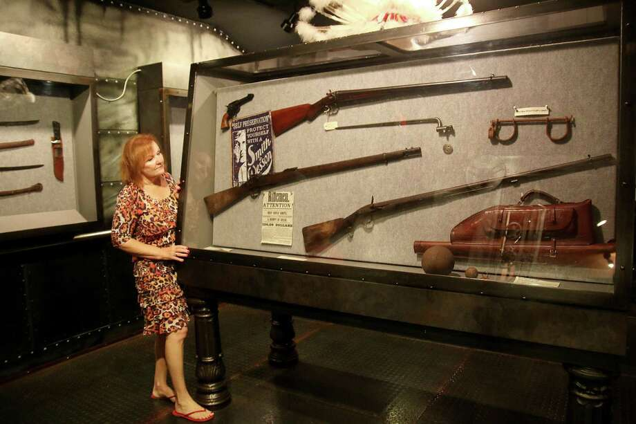 Butler Longhorn Museum and Heritage Park executive director Monica Hughes shows some of the vintage firearms in the museum's Gun Room. Photo: Pin Lim, Freelance / Copyright Forest Photography, 2015.