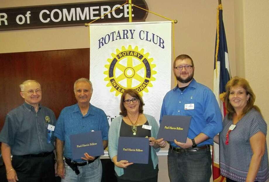The Rotary Club of Friendswood recognized Hassan Moghaddam, Desiree Hopping and Jim Foreman as the organization's Paul Harris Fellows during a recent organizational meeting. They are among six the club recognized for their support of the organization's international humanitarian programs.      The Rotary Club of Friendswood recognized Hassan Moghaddam, Desiree Hopping and Jim Foreman as the organization's Paul Harris Fellows during a recent organizational meeting. They are among six the club recognized for their support of the organization's international humanitarian programs. Photo: Rotary Club Of Friendswood