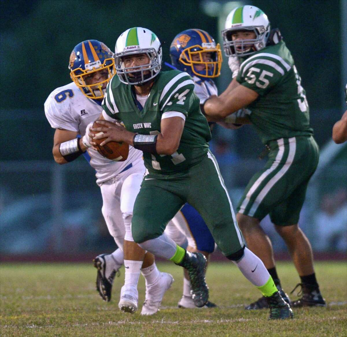 Tyler Hansen (14) Photographs from the high school football game between Brookfield and New Milford high schools on Friday night, September 18, 2015, played at New Milford High School, in New Milford, Conn.