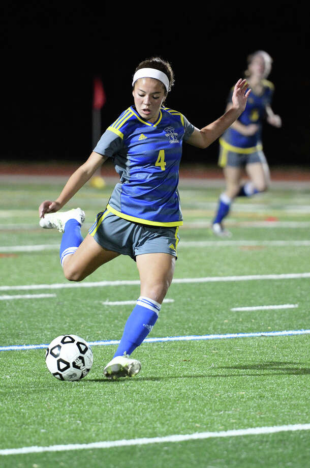 Newtown's Alana Murray (4) controls the ball during the SWC girls soccer semifinals against New Milford at Barlow High School in Redding, Conn. on Tuesday, Nov. 3, 2015. Photo: Amy Mortensen / For Hearst Connecticut Media / Connecticut Post Freelance