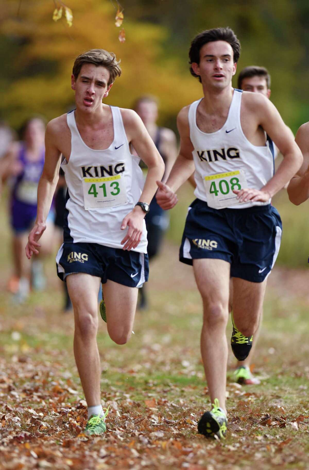 King School runners Jonathan Richter , left, and Richard Jove run in the Fairchester Athletic Association (FAA) high school cross country championships at Waveny Park in New Canaan, Conn. Monday, Nov. 2, 2015. Brunswick School won the boys team championship and School of the Holy Child won the girls team championship.