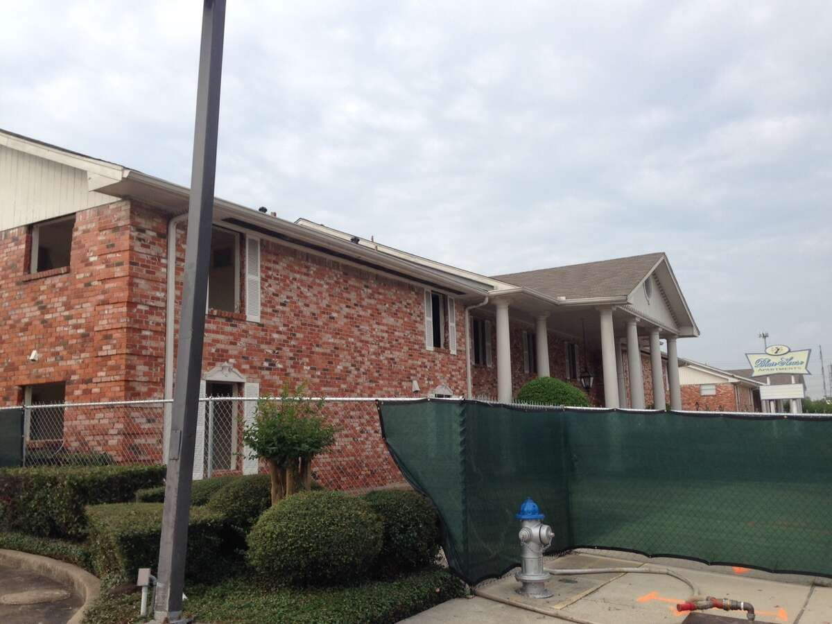Workers began tearing down the Blair House Apartments at 4139 Bellaire on Nov. 4, 2015.