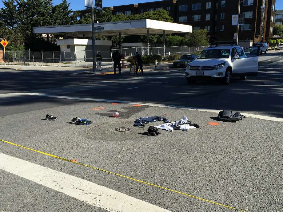 Two 12-year-old boys suffered serious injuries after being struck by a car at Bay and Buchanan streets in San Francisco's Marina district Wednesday morning. The driver of a Volkswagen SUV that struck the boys stayed at the scene and was cooperating with police. Photo: Evan Sernoffsky