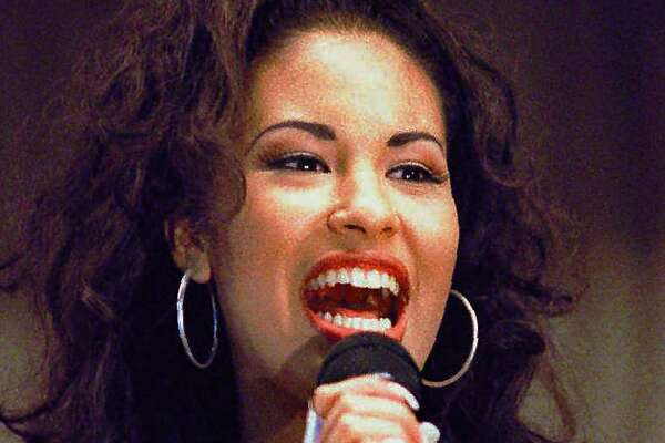 "FILE - In this Nov. 14, 1994 file photo Selena Quintanilla-Perez performs during a concert in Corpus Christi, Texas. A new song by Selena has been released two decades after she was killed by her fan club president. Selena's father says he found a recording of the song, ""Oh No (I'll Never Fall in Love Again),"" in Sept. 2015. (AP Photo/George Gongora-Corpus Christi Caller-Times, File) MANDATORY CREDIT; MAGS OUT; TV OUT"