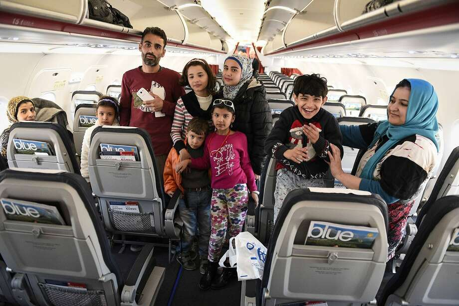 Refugees wait inside an aircraft to depart from Athens to Luxembourg. It was the first trip from Greece under a new EU relocation plan but only a fraction of the hundreds of thousands of asylum- seekers who have entered Greece, Photo: Andrea Bonetti, Associated Press