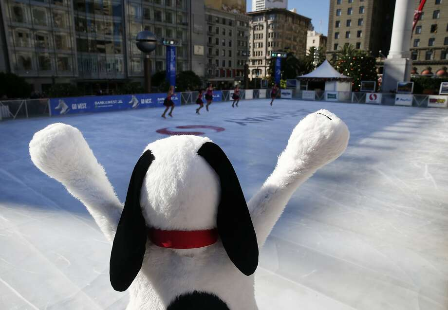 Snoopy cheers for a performance by the Tremors synchronized skating team at the official opening of the holiday season ice skating rink on Union Square in San Francisco, Calif. on Wednesday, Nov. 4, 2015. Photo: Paul Chinn, The Chronicle