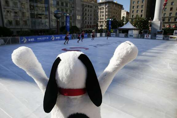 Snoopy cheers for a performance by the Tremors synchronized skating team at the official opening of the holiday season ice skating rink on Union Square in San Francisco, Calif. on Wednesday, Nov. 4, 2015.