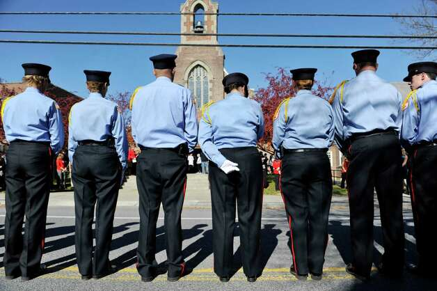 Members of the Coeymans Fire department gather outside of St. Patrick's Church for the funeral of  Robert Prior on Wednesday, Nov. 4, 2015, in Ravena, N.Y.  Prior was  killed when he was hit by a wrong-way driver on Saturday.  Prior was the current commissioner of the Coeymans Fire District and he was past chief of the Coeymans Fire Company.  (Paul Buckowski / Times Union) Photo: PAUL BUCKOWSKI / 00034075A
