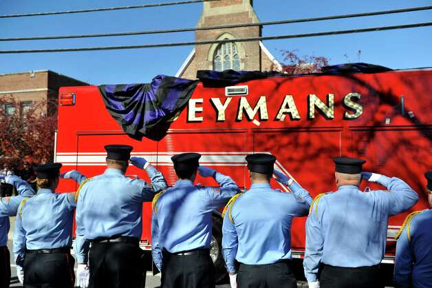 Members of the Coeymans Fire department salute as the funeral procession arrives at St. Patrick's Church for the funeral of  Robert Prior on Wednesday, Nov. 4, 2015, in Ravena, N.Y.  Prior was  killed when he was hit by a wrong-way driver on Saturday.  Prior was the current commissioner of the Coeymans Fire District and he was past chief of the Coeymans Fire Company.  (Paul Buckowski / Times Union) Photo: PAUL BUCKOWSKI / 00034075A
