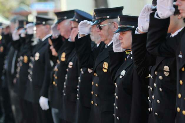 Firefighters from various area fire departments salute as the funeral procession arrives at St. Patrick's Church for the funeral of  Robert Prior on Wednesday, Nov. 4, 2015, in Ravena, N.Y.  Prior was  killed when he was hit by a wrong-way driver on Saturday.  Prior was the current commissioner of the Coeymans Fire District and he was past chief of the Coeymans Fire Company.  (Paul Buckowski / Times Union) Photo: PAUL BUCKOWSKI / 00034075A