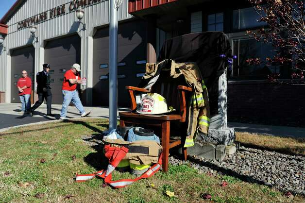 The helmet and turnout gear of Robert Prior is set up on an empty chair outside the Coeymans Fire Company No. 1   for the funeral of Prior on Wednesday, Nov. 4, 2015, in Ravena, N.Y.  Prior was  killed when he was hit by a wrong-way driver on Saturday.  Prior was the current commissioner of the Coeymans Fire District and he was past chief of the Coeymans Fire Company.  (Paul Buckowski / Times Union) Photo: PAUL BUCKOWSKI / 00034075A