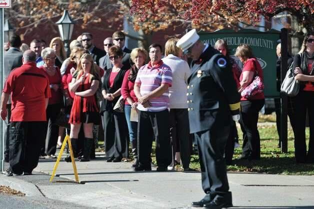 Mourners gather outside of St. Patrick's Church for the funeral of  Robert Prior on Wednesday, Nov. 4, 2015, in Ravena, N.Y.  Prior was  killed when he was hit by a wrong-way driver on Saturday.  Prior was the current commissioner of the Coeymans Fire District and he was past chief of the Coeymans Fire Company.  (Paul Buckowski / Times Union) Photo: PAUL BUCKOWSKI / 00034075A
