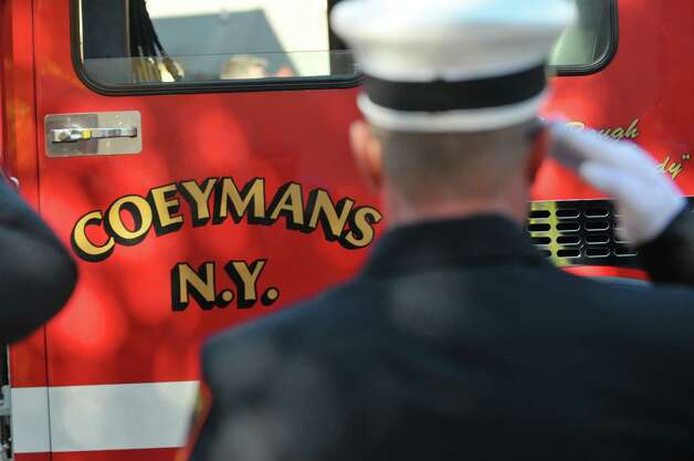 Firefighters salute as the funeral procession arrives at St. Patrick's Church for the funeral of  Robert Prior on Wednesday, Nov. 4, 2015, in Ravena, N.Y.  Prior was  killed when he was hit by a wrong-way driver on Saturday.  Prior was the current commissioner of the Coeymans Fire District and he was past chief of the Coeymans Fire Company.  (Paul Buckowski / Times Union) Photo: PAUL BUCKOWSKI / 00034075A