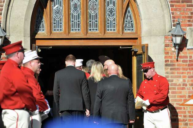 Family members of Robert Prior make their way into St. Patrick's Church for the funeral of  Prior on Wednesday, Nov. 4, 2015, in Ravena, N.Y.  Prior was  killed when he was hit by a wrong-way driver on Saturday.  Prior was the current commissioner of the Coeymans Fire District and he was past chief of the Coeymans Fire Company.  (Paul Buckowski / Times Union) Photo: PAUL BUCKOWSKI / 00034075A