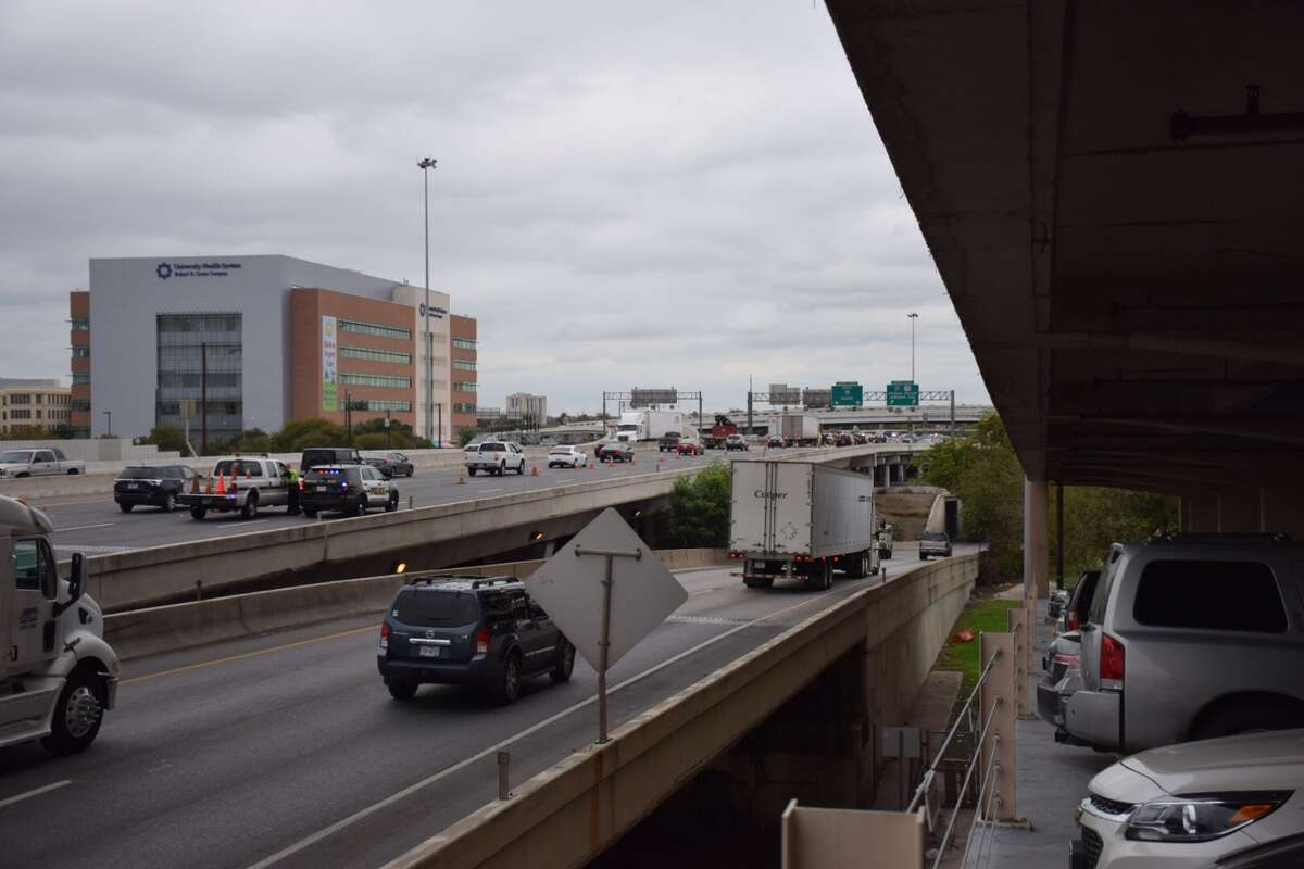 The upper level of northbound Interstate 35 has been shut down following a crash involving a San Antonio Police Department motorcycle officer.