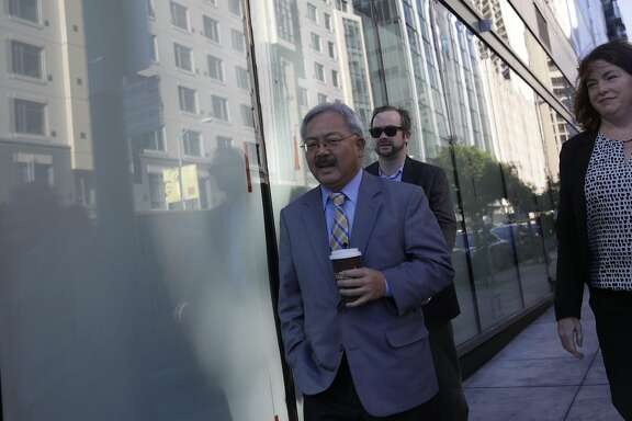 Mayor Ed Lee walks down 10th Street alongside 1400 Mission on his way to an opening celebration welcoming new residents to 1400 Mission Street on Wednesday, November 4,  2015 in San Francisco, Calif. 1400 Mission is a 190 unit, 15-floor affordable family housing project.