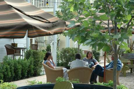 Guests at the Tallman Hotel in Upper Lake can enjoy the courtyard, left, that connects to the Blue Wing Saloon. Photo: Christine Delsol, The Chronicle