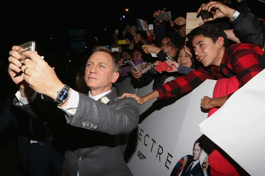 "Actor Daniel Craig signs autographs and takes selfies with fans during the ""Spectre"" Mexico City premiere at Auditorio Nacional on November 2, 2015 in Mexico City, Mexico. Photo: Victor Chavez, WireImage"