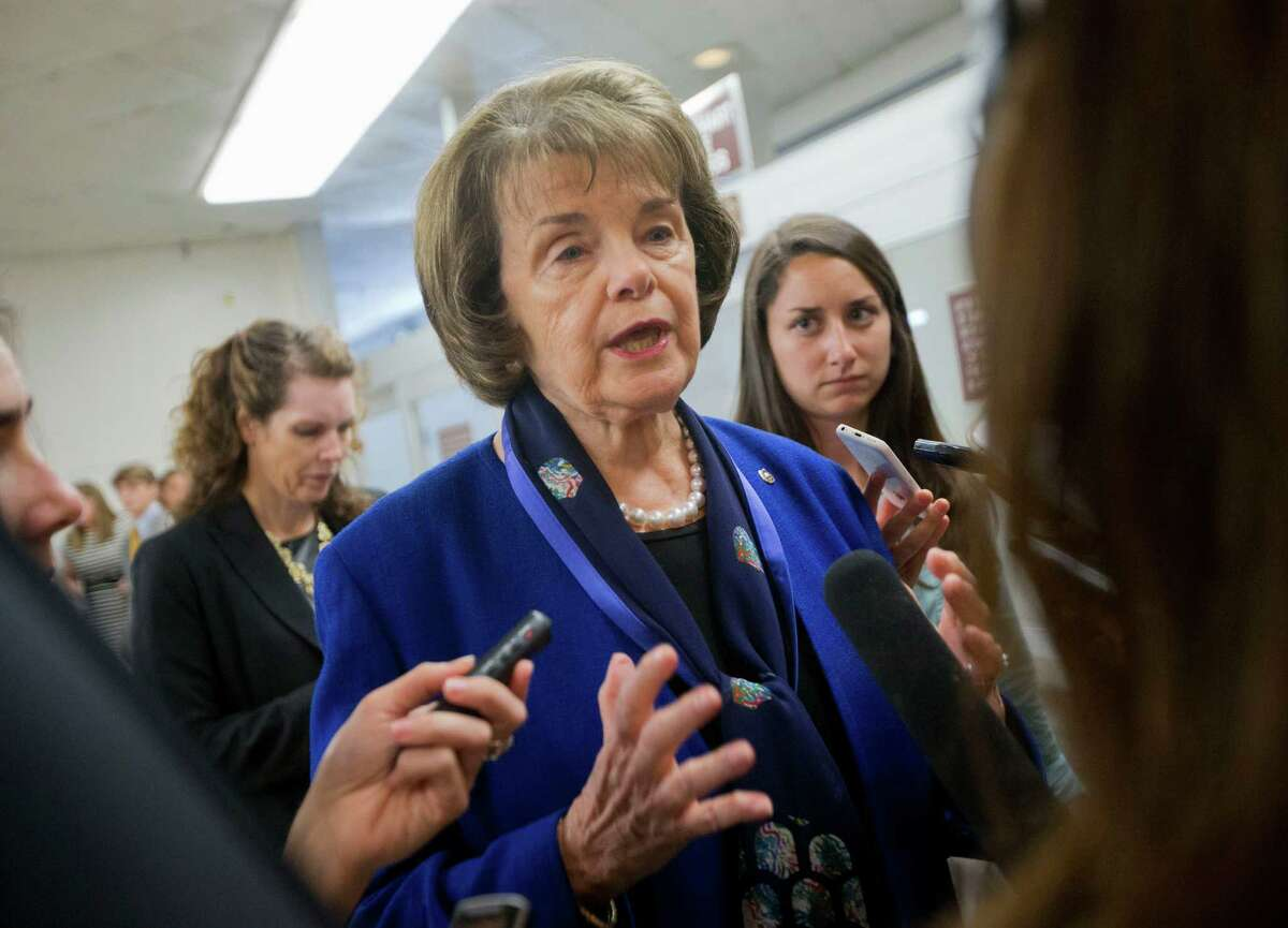 Sen. Dianne Feinstein, D-Calif. speaks with reporters on Capitol Hill in Washington in June. The senator has called for an end to the controversial EB-5 regional center program that lets foreign nationals pay for green cards for themselves and their families.
