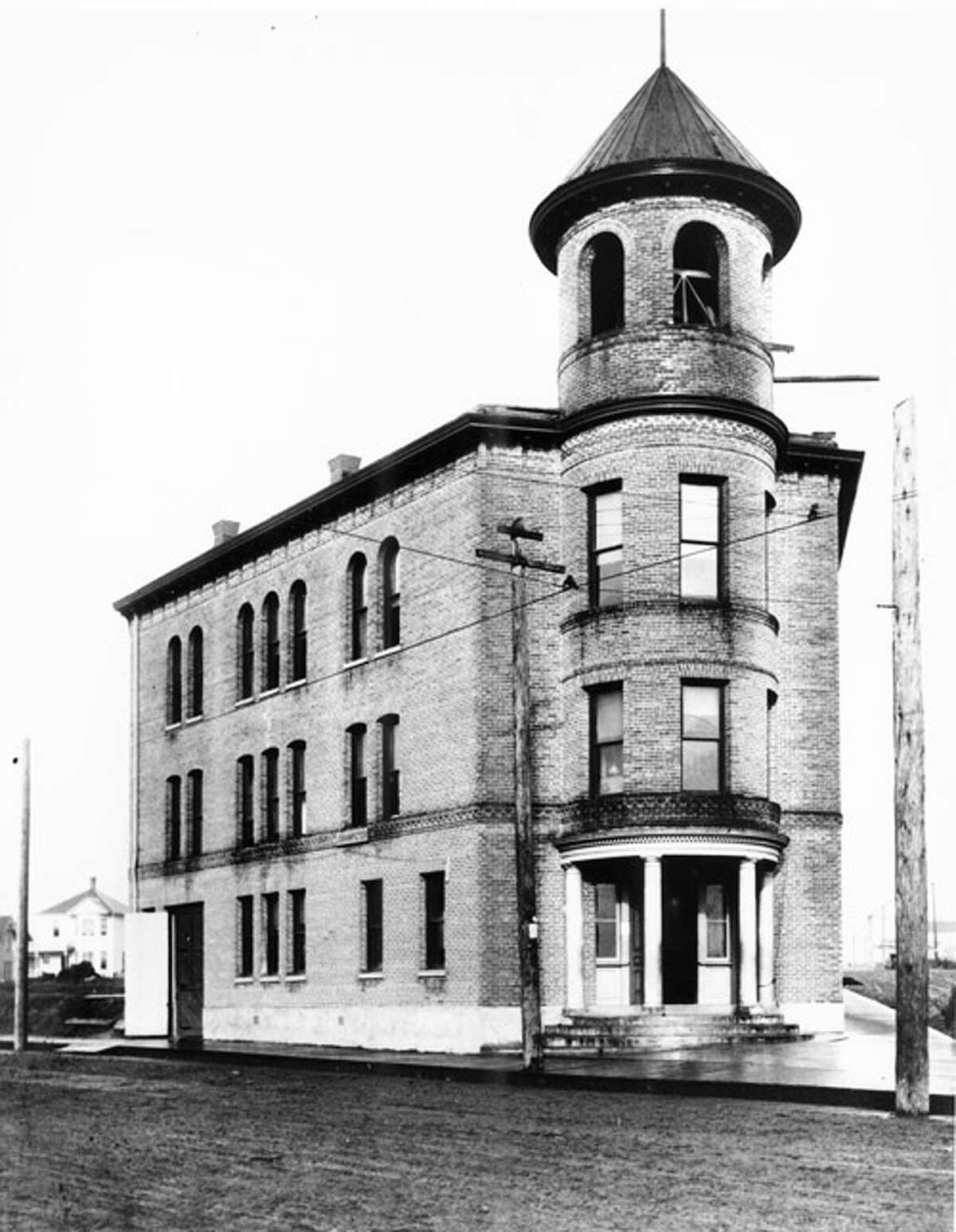 Ballard's old City Hall included the fire department, city offices, community meeting rooms, a ballroom and the jail, according to Seattle Municipal Archives caption information. This photo from 1902 shows the building five years before Ballard cast off its independence in favor of joining Seattle. The building was torn down in 1965. Photo courtesy Seattle Municipal Archives, University of Washington Special Collections, A. Curtis 00881.