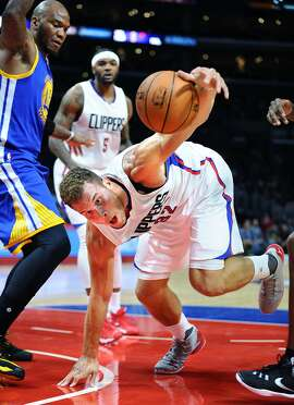 The Los Angeles Clippers' Blake Griffin tries to gain control of the ball in front of the Golden State Warriors' Marreese Speights, left, in preseason action at Staples Center in Los Angeles on Tuesday, Oct. 20, 2015. (Wally Skalij/Los Angeles Times/TNS)
