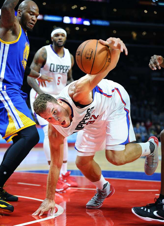 The Los Angeles Clippers' Blake Griffin tries to gain control of the ball in front of the Golden State Warriors' Marreese Speights, left, in preseason action at Staples Center in Los Angeles on Tuesday, Oct. 20, 2015. (Wally Skalij/Los Angeles Times/TNS) Photo: Wally Skalij, McClatchy-Tribune News Service