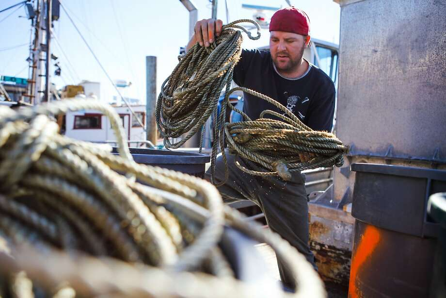 A fisherman named Loren does daily chores on the Willanina crab and fishing boat, at Fisherman's Wharf in San Francisco, California on Wednesday, November 4, 2015. Despite state health officials concerns that crabs along the coast of California are too toxic to eat, fisherman continue to go about their chores to get ready for the season. Photo: Gabrielle Lurie, Special To The Chronicle