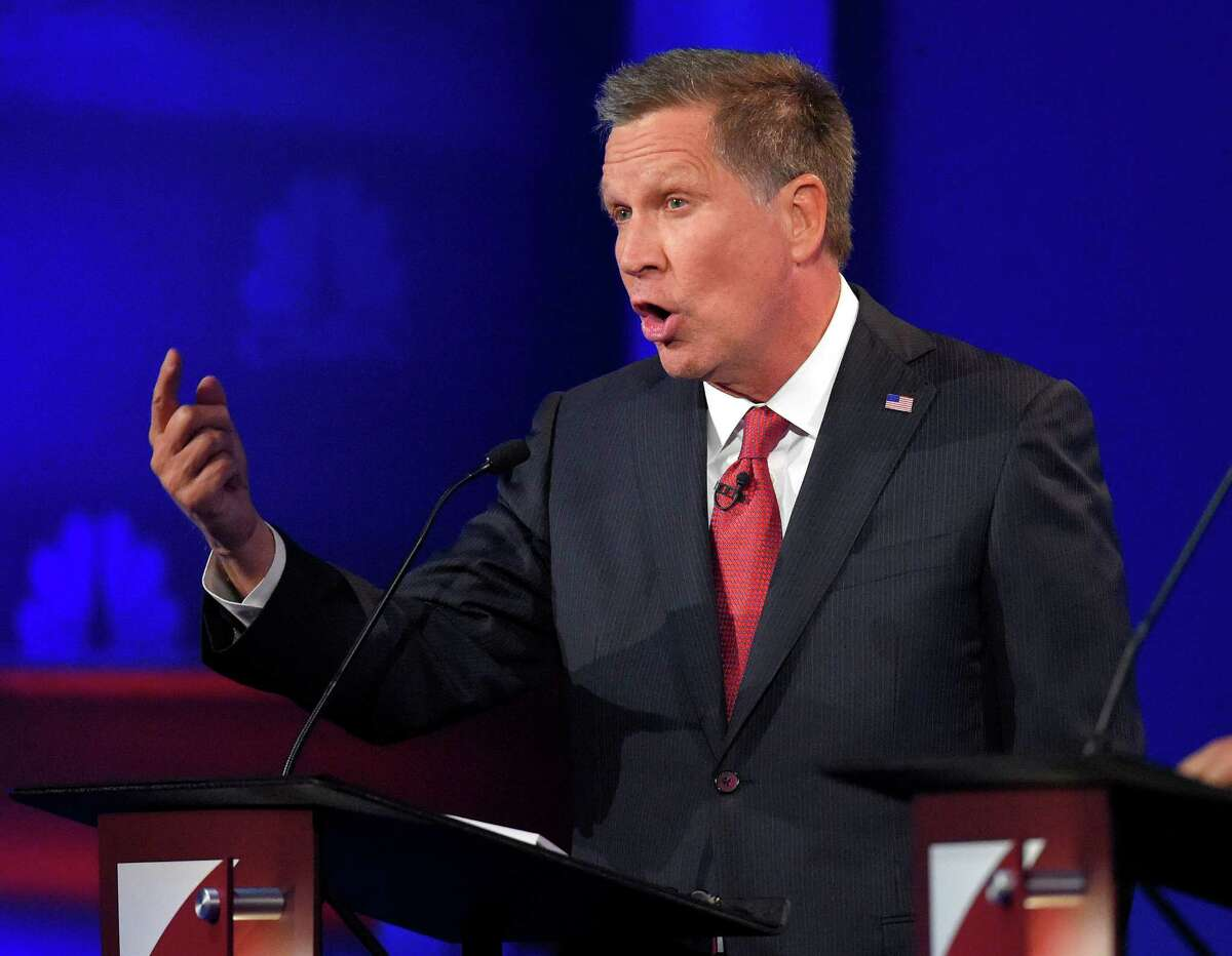 John Kasich makes a point during the CNBC Republican presidential debate at the University of Colorado last week. The Ohio governor uses his religion to defend his support for government spending.