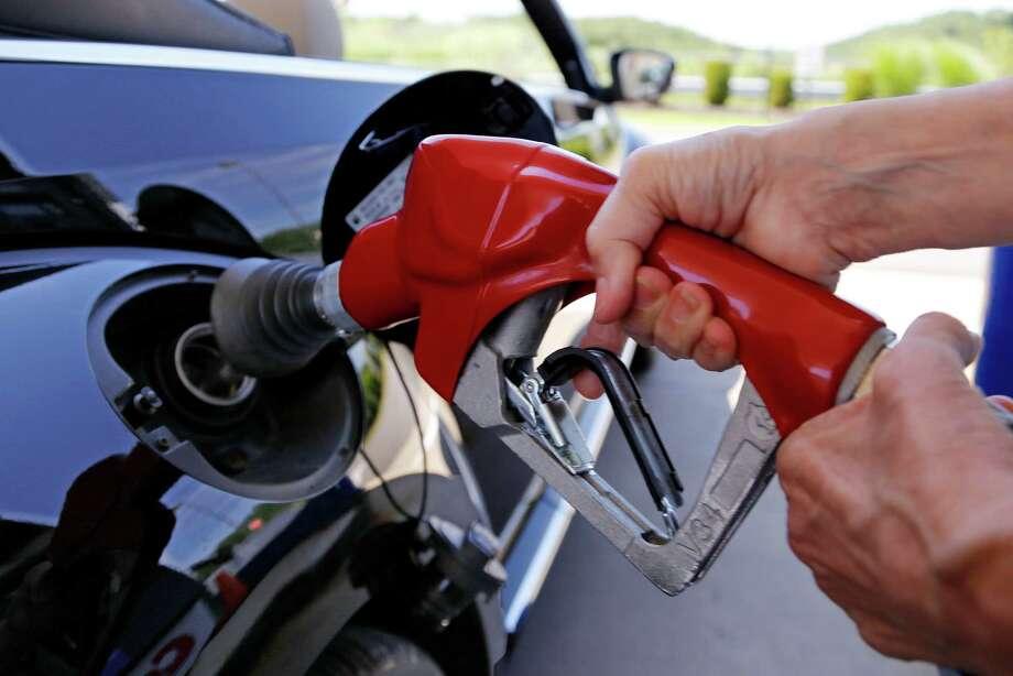 Most Americans will spend less than $2 per gallon for gasoline this holiday season.  (AP Photo) Photo: Gene J. Puskar, STF / AP