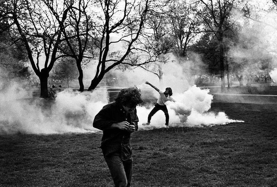 """Throwing Back Tear Gas, Cambodian Invasion Riot, Columbus, Ohio"" was picked up by news wire services at the time. Photo: Ken Light, Handout"