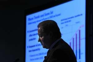 Houston oil co. announces spending cut, posts loss - Photo