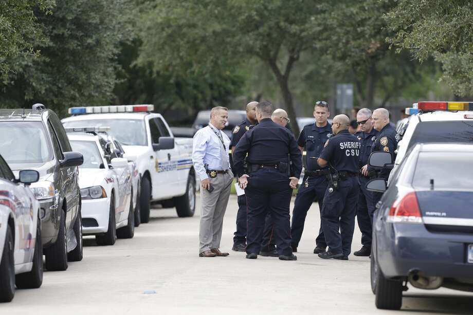 Police are shown at the scene of a shooting at 20300 block of Silverwood Trail in Cypress. Photo: Melissa Phillip / Houston Chronicle