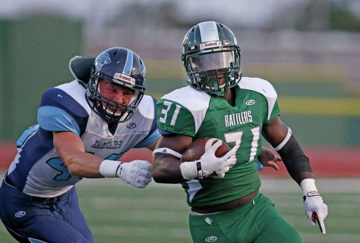 Reagan's Ian Leslie outraces Johnson's Dylan James at Comalander Stadium on Oct. 3, 2015.